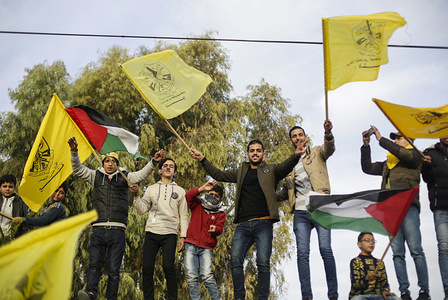 Palestinians waving yellow Fatah flags during a rally marking the 55th anniversary of the Fatah movement founding. Fatah is a secular Palestinian party and former guerrilla movement founded by the late Palestinian leader, Yasser Arafat.