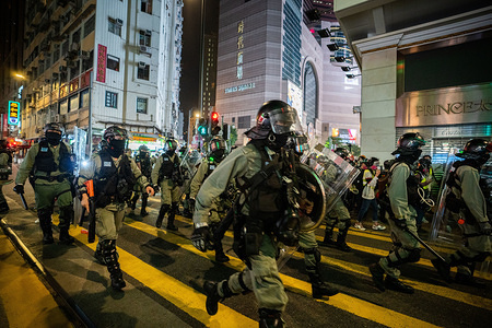 Riot police officers in formation rushing to arrest protesters during the new year day demonstration. The unrest in Hong Kong shows no sign of a abating in 2020, with the new year marked by rallies showing continued resistance against Beijing's tightening grip over the financial hub.