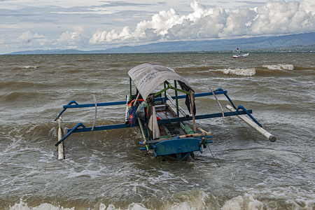 A fishing boat anchored on the shoreline. High waves in the waters of Palu Bay forced Hundreds of fishermen in the village of Lere to anchor their boats. According to the Palu Meteorology, Climatology and Geophysics Agency (BMKG) the waves reached two meters to three meters, considered quite dangerous for fishermen.