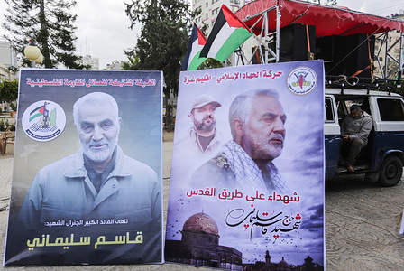 Placards with pictures of Qassem Soleimani, the Iran's head of the Quds Force who was killed during the US air strike are seen during the event in Gaza City.
