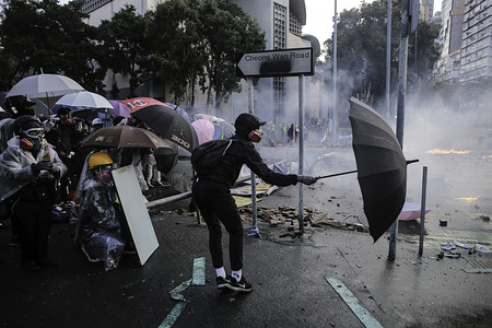 Protesters use umbrellas as shields during the demonstration. Riot police and Protesters clashed in the surroundings of Hong Kong Polytechnic University after a day of relative calm, Clashes between protesters and riot police started at night when police tried to break in the barricades firing teargas and were received by protesters that responded with petrol bombs and bricks. Most of the fighting concentrated at the intersection of the school's main entrance.