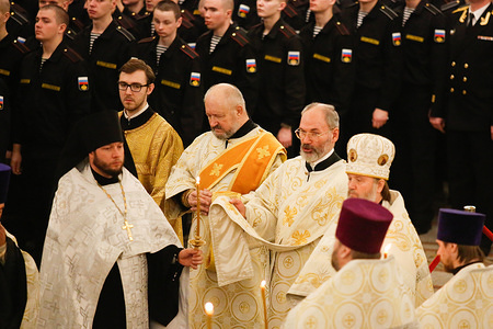 Orthodox Priests and Navy Sailors attend the Orthodox Christmas service at Kronshtadt Navy Cathedral.