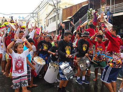 Children chant slogans during the procession. Hundreds of Black Nazarene devotees around the country joined the procession and blessing of the replicas through the streets of Quiapo in Manila. It shows the Filipinos deep faith and devotion to the Black Nazarene.