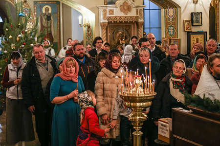 Believers pray during the Orthodox Christmas celebrations at the Church of Nativity of the Blessed Virgin Mary in Kiev