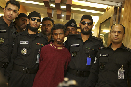 DHAKA, BANGLADESH, JANUARY 8, 2020: RAB officials along with the arrested suspect at the Media Centre of Rapid Action Battalion (RAB) at Karwan Bazar in Dhaka. The Rapid Action Battalion (RAB) has said the prime suspect of the Dhaka University student rape case has confessed of being a serial rapist during the primary interrogation.
