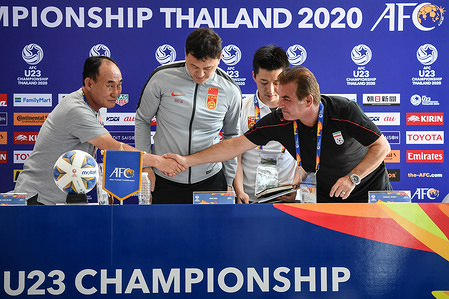 Kim Hak-bum (L), head coach of the South Korean, Hamid Estili, head coach of Ir Iran shake hands during the post-match press conference of the AFC U23 Championship at Tinsulanon Stadium. Other Group C nations are China, Iran and Uzbekistan. The tourney is set for Jan. 8-26.