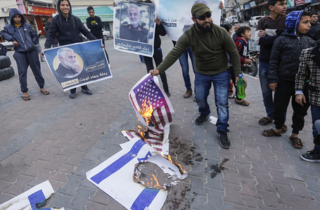 Palestinians burn American and Israeli flags in honour of the Iranian military commander Qassem Soleimani and celebrate the series of missiles launched by Iran in Iraqi bases that harbour American forces.