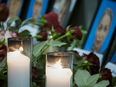 KIEV, UKRAINE, JANUARY 9, 2020: Flowers and candles placed in front of the portraits of the victims of flight PS752.  Spontaneous memorial corner of the Borispyl airport. Ukraine's International Airlines plane crashed on January 8, 2020 shortly after taking off from Imam Khomeini Airport in Tehran, Iran.