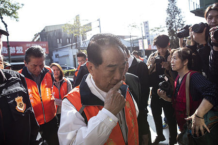 Presidential candidate James Soong chu-yu of the People First Party arrive for a party meeting ahead of the January 11 presidential and parliamentary elections.