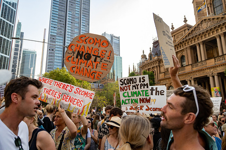 Protesters hold placards during the demonstration. Thousands of climate change protesters surround Sydney's Town Hall as the bush-fire crisis continues in Australia. Similar protests took place across other state capitals.