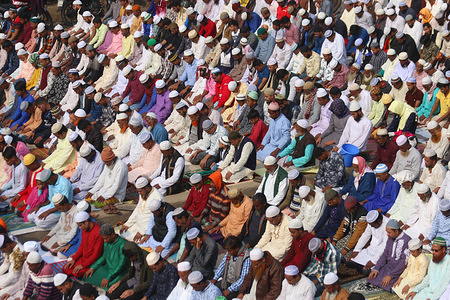 """DHAKA, BANGLADESH, JANUARY 10, 2020: Muslim devotees offer prayers during the World Muslim Congregation, also known as """"Biswa Ijtema"""" at Tongi on the outskirts of Dhaka. Millions of Muslim devotees from around the world join the four-day long event that ends with a special prayer on the final day."""