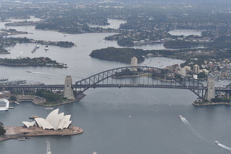Aerial view of the Sydney Harbour Bridge and the Opera House in Sydney.
