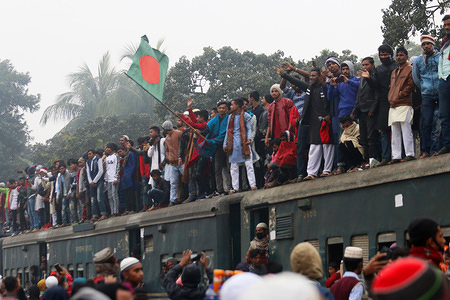 Muslim devotees return home on an overcrowded train after the event. Muslim devotees take part in the Akheri Munajat or final prayers of the annual gathering 'Biswa Ijtema' which is considered the world's second largest Muslim gathering after Hajj.