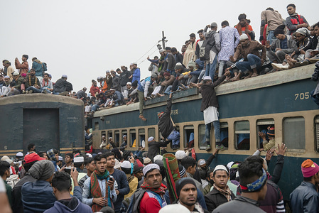 Muslims return home on overcrowded trains after attending the final prayer of the first phase of Bishwa Ijtema, which is considered as the world's second-largest Muslim gathering after Haj.