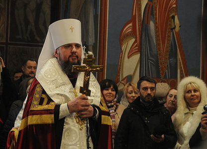 Metropolitan Epiphanius holds a cross during the consecration ceremony of icons at St. Michael, Golden-Domed Monastery in Kiev.