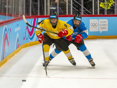 LAUSANNE, SWITZERLAND - JANUARY 12 2020: Luisa Wilson (yellow) and a player (blue) compete during the women's mixed NOC 3-on-3 ice hockey preliminary round (game 20; blue Vs yellow) on Day 3 of the Lausanne 2020 Winter Youth Olympic Games at Vaudoise Arena.