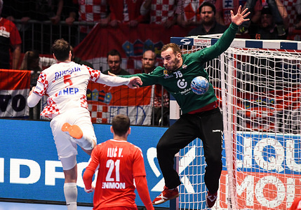 GRAZ, AUSTRIA - JANUARY 13 2020: Domagoj Duvnjak of Croatia and Vladimir Cupara of Serbia are seen in action during the handball match between National teams of Serbia and Croatia in Group A of Men's EHF EURO 2020 in Graz.