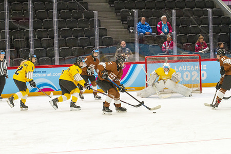 Players in action during the women's mixed NOC 3-on-3 ice hockey preliminary round (game 28; brown v. yellow), during Day 4 of the Lausanne 2020 Winter Youth Olympic Games, at Lausanne Skating Arena. (Final Score: Brown 10 - 6 Yellow)