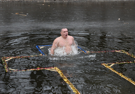 A man takes a dip during the celebrations of Epiphany. Following the Julian calendar, the Ukrainian Orthodox Church celebrates the feast of Epiphany on January 19 marking the baptism of Jesus in the Jordan River and his manifestation to the world as the Son of God.