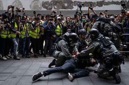 Riot police apprehend a protester outside Chater Gardens during the demonstration. Thousands of demonstrators gather at Chater Gardens to urge foreign governments to consider sanctions against Hong Kong administration if demands for full democracy are not met.