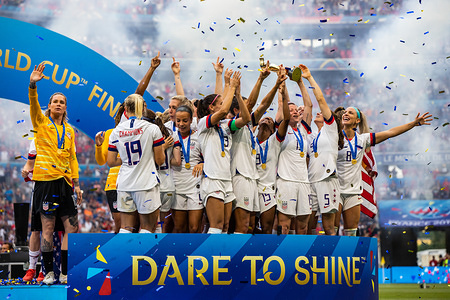 USA women's national team celebrating with trophy after the 2019 FIFA Women's World Cup Final match between The United States of America and The Netherlands at Stade de Lyon. (Final score; USA - Netherlands 2:0)
