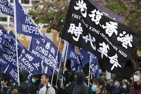 A pro-democrats protesters holding Hong Kong Independence flags (Blue) and Free Hong Kong flag (black) during the assembly. The Hong Kong Civil Assembly Team organised a Sunday Assembly to make awareness and promote their coming march on Sunday January 19th, 2020 for Universal Siege on Communists.