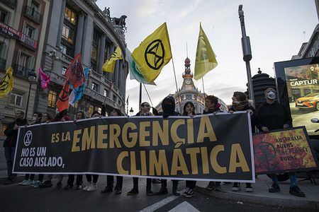 Protesters blocked Alcala Street while holding Extinction Rebellion Flags and a banner during the demonstration. Climate change activists from Extinction Rebellion are calling on Australian politicians to do more to protect citizens and wildlife from the ongoing bushfire crisis, as well as demanding action from leaders worldwide to prevent climate change.