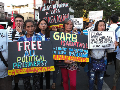 Protesters hold placards during the demonstration. The Unyon ng mga Manggagawa sa Agrikultura called on the Filipino people to join the fight for genuine agrarian reform to deliver the ultimate justice for the victims of Mendiola Massacre, commemorating the 33rd year of the cold-blooded killing of the 13 farmers at the foot of Mendiola Bridge in Manila.