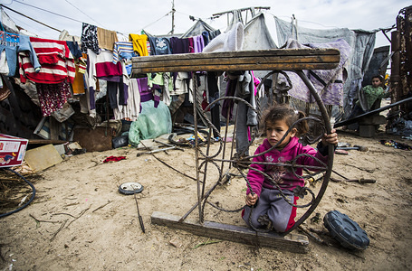 A Palestinian girl plays at her house in the Al-Zuhur neighbourhood. On the outskirts of Khan Yunis camp is the Al-Zuhur neighbourhood with bare feet children, surrounded by mountains of garbage, with high poverty rate and little hope for the future.