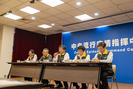 Chen Shih-chung (C) (Taiwanese Minister of Health and Welfare) speaks  during a press conference at the Central Epidemic Command Center in Taipei. With more than 570 infected cases in the city of Wuhan (China) put on lockdown, Taiwan CDC announces activation of Central Epidemic Command Center (CECC) in the presence of Chen Shih-chung (Taiwanese Minister of Health and Welfare) for Severe Special Infectious Pneumonia to comprehensively prevent novel coronavirus pneumonia outbreak in China and ensure health of Taiwanese public.