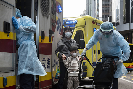 Health care members make first aid to people as they cover their faces with sanitary masks after the first cases of coronavirus have been confirmed in Hong Kong in Hong Kong. China has implemented a public transportation and airport lock down into different cities to slow down the spread of the Wuhan coronavirus.