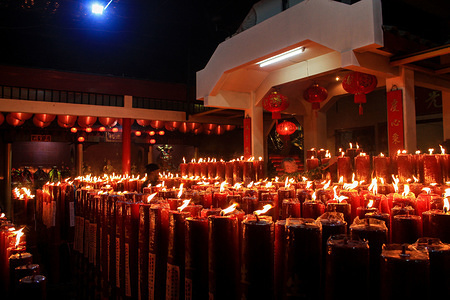 A view of the Dharma Ramsi Temple during the celebration. Hundreds of candles are lit at midnight and Prayers for the 2571 Chinese New Year as an expression of gratitude for all the fortune and for hope of a better life in the year of the rat.
