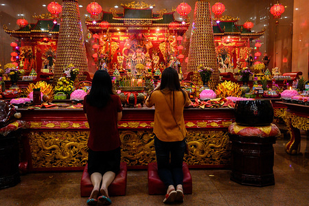 Women pray during the celebration at Xian Ma Temple in Makassar. Hundreds of candles are lit at midnight and Prayers for the Chinese Lunar New Year as an expression of gratitude for all the fortune and for hope of a better life in the year of the rat.