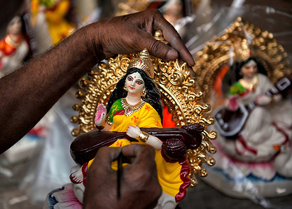 An artist making final touches to an Idol of Hindu Goddess Saraswati during the preparations for the festival. Basant Panchami or Vasant Panchami is a Hindu Festival which celebrates the coming of spring in India.