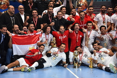 Egypt players celebrate on the podium after winning the Men's CAHB 2020 final match between Tunisia and Egypt at Rades Arena. (Final score; Tunisia 22:27 Egypt)