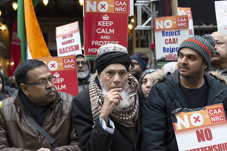 """Protesters hold placards during the demonstration. People gather outside the Indian High Commission in support of minorities that are """"discriminated"""" in India by the CAA (Citizenship Amendment Act) and the NRC (National Register of Citizens)."""