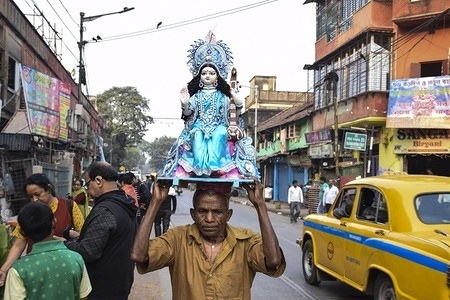A man carrying an idol during the preparation. Basant panchami, is the fifth day of magha a month of the Hindu calendar which is celebrated as Saraswati puja. According to the Hindu calendar Saraswati (Goddess of Wisdom) puja starts on 29th to 30th January.