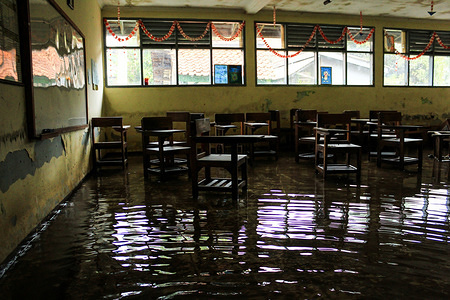 Interior view of flooded classroom at SMPN 1 Bojongsoang middle school in Bandung. A total of 914 students from SMPN 1 Bojongsoang Middle school have been affected by floods. Temporary learning activities are diverted through online applications on smartphones.