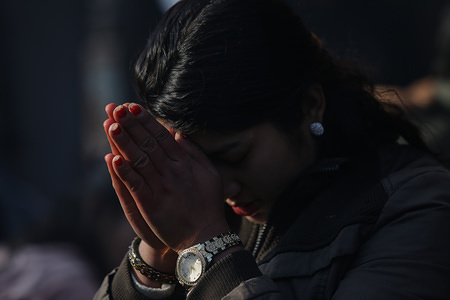 A woman prays at the Saraswati temple during the Shreepanchami festival. Basanta Panchami or Shreepanchami marks the arrival of spring and the festival dedicated to goddess of education Saraswati in belief that the goddess will help devotees excel in education.