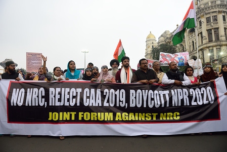 Protesters hold a banner during the demonstration. Joint Forum on Mahatma Gandhis death anniversary organised a protest against NRC (national register for citizenship) and CAA (citizenship amendment act) which was passed in Indian parliament recently.