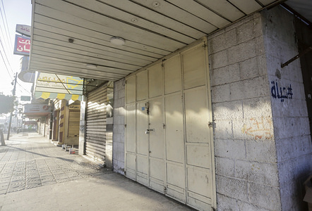 A view of a closed shop during the general strike to stage a protest against the US peace plan in Gaza City.