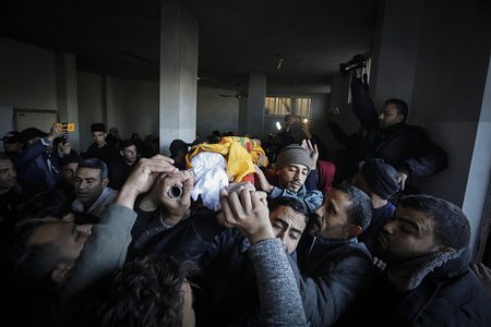 (EDITOR'S NOTE: Image depicts death) Mourners carry the corpse during the funeral in the southern Gaza Strip. Palestinian boy, Alaa Abbasi, 15 died of his wounds sustained during a demonstration on the border between Israel and Gaza.