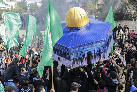 Palestinian demonstrators wave Hamas movement flags and a replica of Jerusalem's Dome of the Rock mosque during a protest against a proposed US peace plan. President Donald Trump's long delayed Middle East peace plan won support in Israel but was bitterly rejected by Palestinians facing possible Israeli annexation of key parts of the West Bank. The plan gives the Jewish state a US green light to annex key parts of the occupied West Bank.