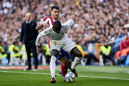Ferland Mendy of Real Madrid and Angel Martin Correa of Atletico de Madrid in action during La Liga match between Real Madrid and Atletico de Madrid at Santiago Bernabeu Stadium.  (Final score: Real Madrid 1 - Atletico de Madrid 0)