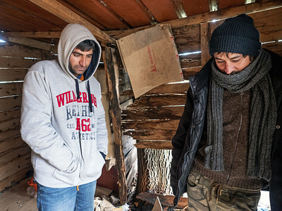 Men from Pakistan showing their squat where they staying during winter in Bihac. In Bosnia and Herzegovina around 8,000 refugees and migrants try to find a way how to cross the border to Croatia and get further to the Western European countries. Some of them live in overcrowded refugee camps, some of them squat in abandoned buildings or simply sleep in the streets. Many of them report that if they are caught on the border by Croatian police, they are beaten, their cash money, smart phones and valuables are stolen, jackets and shoes are burnt and they are beaten by the border guards.
