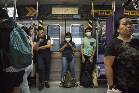 Filipinos wearing face-masks on a train following the virus outbreak. Fear continues to mount in the Philippines over a new corona virus known as 2019-nCoV which originated in Wuhan, China in December 2019. The Philippines' Department of Health announced the country's first case of the virus on 30th January. The number of 2019-nCoV cases worldwide has already surpassed that of the 2003 Sars epidemic.