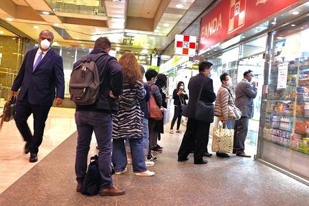 HONG KONG, CHINA, FEBRUARY 3, 2020: People queue up to get masks at the pharmacy in Hong Kong. Hong Kong epidemic situation hit economic hard. The Financial Secretary Paul Chan said that Hong Kong may record a budget deficit this financial year.