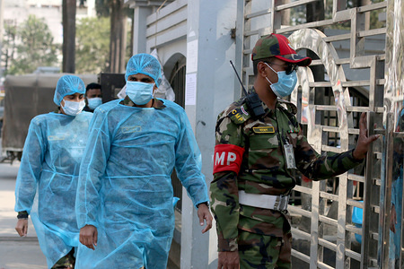 Security personnel wearing face masks as they enter the quarantine centre. Bangladeshi government returns 314 of its citizens from China because of the Corona-virus epidemic. To observe deeply these 314 people the government has put them at a quarantine centre close to Hazrat Shahjalal International airport in Dhaka.