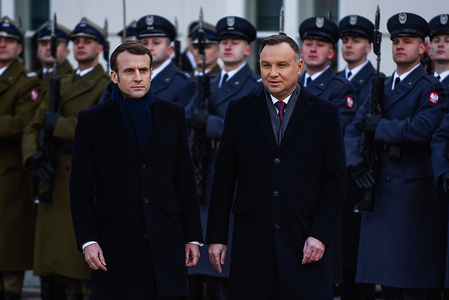 President of Poland, Andrzej Duda and President of France, Emmanuel Macron walk past the honour guards during a welcome ceremony at the Presidential Palace. For the first time in 6 years, A French head of State visits Poland since the relations between both countries worsened after Poland's Law and Justice (PiS) government scrapped a 3.4 billion US dollar helicopter deal with Airbus in 2016.
