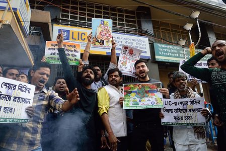 Protesters chant slogans while holding placards in front of the LIC building during the demonstration. Employee unions of Life Insurance Corporation (LIC) are staging agitations across the country against the government's decision to divest part of its stake in the country's largest life insurer.